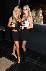 Left to right, NATHALIE DENNING and MISS ANOUSHKA DE GEORGIOU at a party to celebrate a new collection of sexy underware by Janet Reger called 'Naughty Janet' held at 5 Cavendish Square, London on 19th October 2004.<br /><br />MINIMUM REPRODUCTION FEE - SEE OUR WEB SITE<br /><br />NON EXCLUSIVE - WORLD RIGHTS-