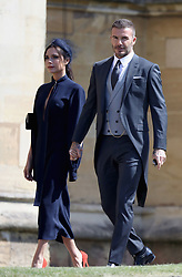 """File photo dated 19/5/2018 of David and Victoria Beckham arriving at the wedding of Meghan Markle and Prince Harry. David Beckham has said he has learned to ignore the negative things that are said about his family, as he admitted that his marriage to Victoria is """"hard work""""."""