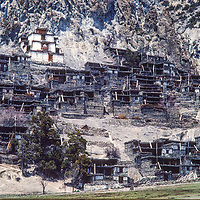 Stone houses and a Tibetan Buddhist gompa (temple) climb up a hillside in Braga village in the Manang Valley north of Annapurna in Nepal.