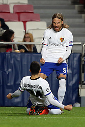 December 5, 2017 - Lisbon, Portugal - Basel's midfielder Mohamed Elyounoussi from Norway celebrates with Basel's defender Michael Lang from Suisse (R ) after scoring a goal during the UEFA Champions League Group A football match between SL Benfica and FC Basel at the Luz stadium in Lisbon, Portugal on December 5, 2017. (Credit Image: © Pedro Fiuza/NurPhoto via ZUMA Press)