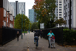 © Licensed to London News Pictures . 11/10/2018. Salford , UK . GV of Spruce Court (l) and Thorn Court (c) . Recently installed cladding at several council-owned tower blocks in Salford has been identified as having similar dangerous properties to that which was installed on the Grenfell Tower in London . Residents have been waiting months for clarification on what action will be taken to make their homes safe . Photo credit : Joel Goodman/LNP
