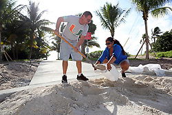 James Kiernan and Liz Hankins, of North Lauderdale, fill trash bags with sand on Pompano Beach in preparation for Hurricane Irma on Friday, Sept. 8, 2017.  (Amy Beth Bennett /Sun Sentinel/TNS/Sipa USA)<br />