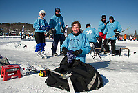 """The """"Frozen Piggies"""" after their win over """"Laughing Skulls"""" in the Twig division Pool Play on Saturday afternoon during New England Pond Hockey.  (Karen Bobotas/for the Laconia Daily Sun)"""