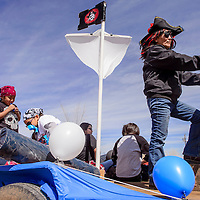 Corinna Chatter, right, pilots a mock pirate ship in a parade for the state champion Valley Sanders Pirates in Sanders Friday.