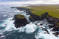 Dramatic cliffs and Moo Stack on coast at Eshaness at Northmavine , north mainland of Shetland Islands, Scotland, UK