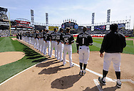 CHICAGO - APRIL 5:  Members of the Chicago White Sox and Cleveland Indians lineup for the National Anthem  prior to the game on April 5, 2010 a U.S. Cellular Field in Chicago, Illinois.  The White Sox defeated the Indians 6-0.  (Photo by Ron Vesely)