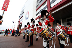 Military drummers perform outside the ground before the match