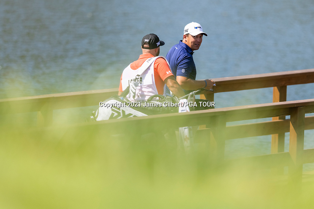 NEWBURGH, IN - SEPTEMBER 05: Justin Lower walks with his caddie across a bridge to the 13th hole during the final round of the Korn Ferry Tour Championship presented by United Leasing and Financing at Victoria National Golf Club on September 5, 2021 in Newburgh, Indiana. (Photo by James Gilbert/PGA TOUR via Getty Images)