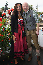 06.10.2013, Kaefers Wiesenschaenke, Muenchen, GER, der FC Bayern Muenchen beim Oktoberfest, im Bild Matthias Sammer, Sporting Director of Bayern Muenchen poses with his wife Karin Sammer in front of the ensemble of the Bavaria statue, a monumental bronze sand-cast 19th-century statue and the Hall of Fame (Ruhmeshalle). The Bavaria is the female personification of the Bavarian homeland and by extension its strength and glory Sammer; Karin Sammer // during the Oktoberfest 2013 beer festival at Kaefers Wiesenschaenke in Munich, Germany on 2013/10/06. EXPA Pictures © 2013, PhotoCredit: EXPA/ Eibner/ Eckhard Eibner<br /> <br /> ***** ATTENTION - OUT OF GER *****
