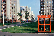While her pet spaniel plays outside, a 1990s resident of a Budapest housing estate makes a call in a phone kiosk,<br /> on 13th June 1990, in Budapest, Hungary. (Photo by Richard Baker / In Pictures via Getty Images)