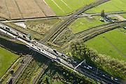 Nederland, Zuid-Holland, Gouda, 23-10-2013; A20 ten zuiden van knooppunt Gouwe met snelverkeer, spoorlijn richting Gouda. Rechtsboven een manege met boerderij.<br /> Rail road crosses motorway A20 near Gouda.<br /> luchtfoto (toeslag op standaard tarieven);<br /> aerial photo (additional fee required);<br /> copyright foto/photo Siebe Swart.