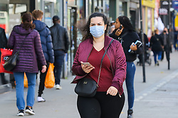 © Licensed to London News Pictures. 19/10/2020. London, UK. A women wearing face covering in north London as tougher measures are put in place in the capital to manage increasing cases. Over 10,000 people in London have  tested positive for COVID-19 in the past week. Photo credit: Dinendra Haria/LNP