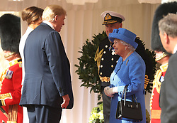 US President Donald Trump and his wife Melania are greeted by Queen Elizabeth II as they arrive at Windsor Castle, Windsor.