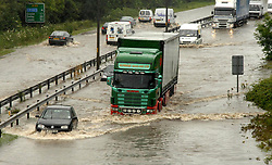 File photo dated 25/06/07 of motorists driving through deep flood water on the A63 road into Hull. The 2007 floods which brought devastation to Sheffield and Hull and left three people dead are being remembered 10 years after the deluge.