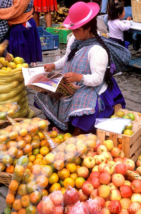 ECUADOR, HIGHLANDS, CUENCA vendor in outdoor produce market
