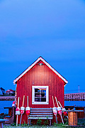 A red fish house against the blue sky in twilight at Orrs Island, Maine.