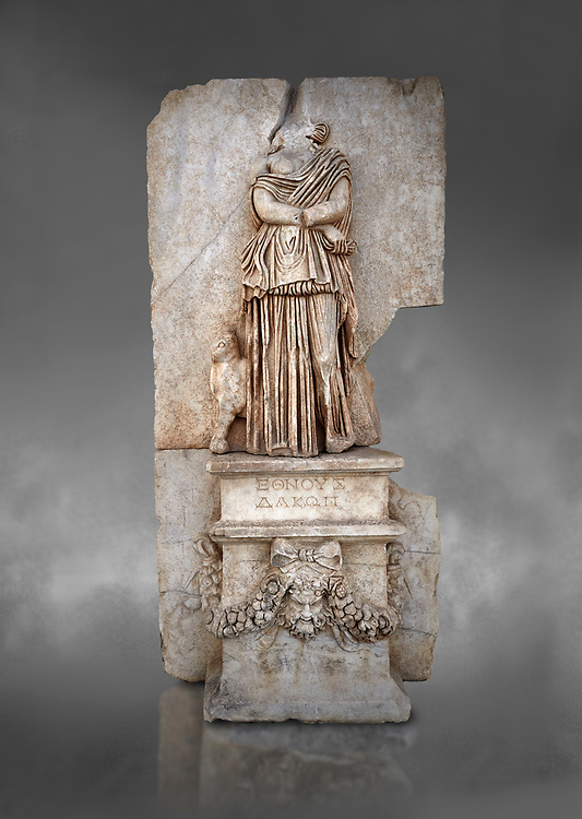 Roman Sebasteion relief sculpture of Ethnos of the Dacians Aphrodisias Museum, Aphrodisias, Turkey. Against a grey background.<br /> <br /> The Dacians are shown as a captive Barbarian woman. Her arms are crossed in submission, her thick dress slips off the shoulder slightly partly revealing her breast. The forepart of a small bull stands in profile behind. Dacia (modern Romania) was claimed by Augustus as a conquest in 1BC to 4AD .<br /> <br /> If you prefer to buy from our ALAMY STOCK LIBRARY page at https://www.alamy.com/portfolio/paul-williams-funkystock/greco-roman-sculptures.html . Type -    Aphrodisias     - into LOWER SEARCH WITHIN GALLERY box - Refine search by adding a subject, place, background colour, museum etc.<br /> <br /> Visit our ROMAN WORLD PHOTO COLLECTIONS for more photos to download or buy as wall art prints https://funkystock.photoshelter.com/gallery-collection/The-Romans-Art-Artefacts-Antiquities-Historic-Sites-Pictures-Images/C0000r2uLJJo9_s0