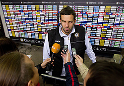 Goalkeeper Samir Handanovic of Udinese with journalists after football match between Udinese Calcio and Palermo in 8th Round of Italian Seria A league, on October 24, 2010 at Stadium Friuli, Udine, Italy.  Udinese defeated Palermo 2 - 1. (Photo By Vid Ponikvar / Sportida.com)