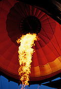 A fiery blast of heat from the jets inside a hot air balloon headed out over the Wadi Rum Desert - Jordan