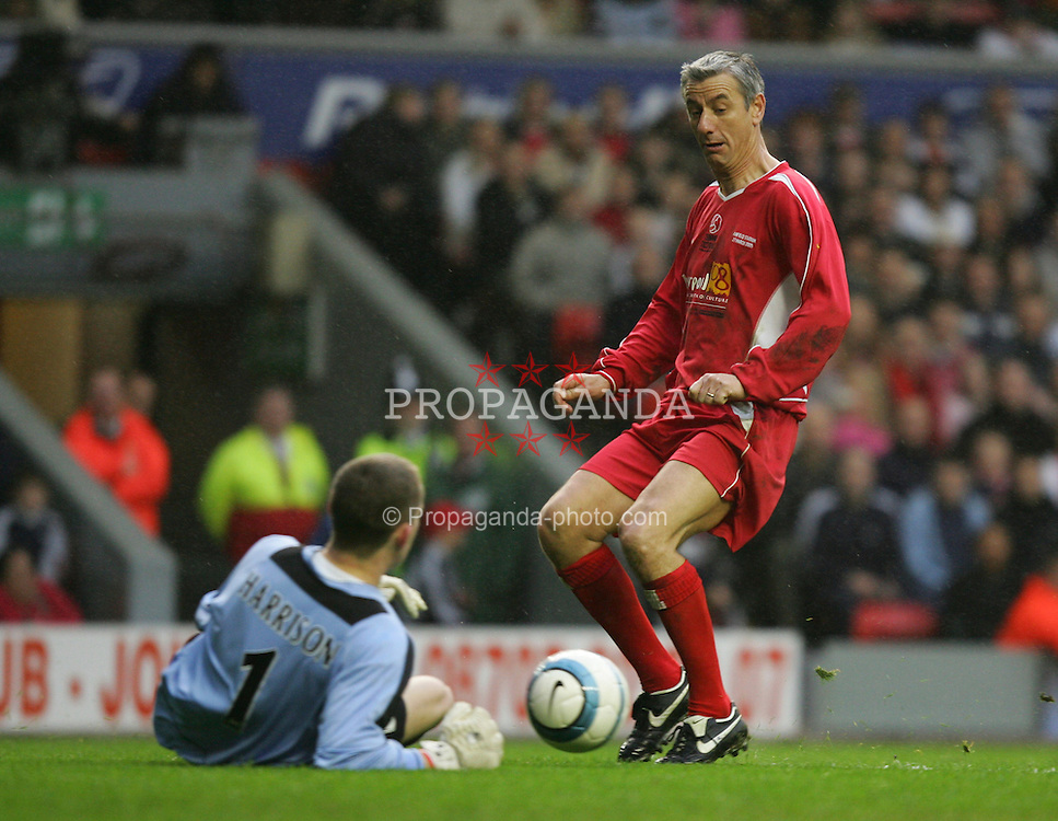 LIVERPOOL, ENGLAND - SUNDAY MARCH 27th 2005: Liverpool Legends' Ian Rush sees his shot saved by Celebrity XI's goalkeeper Paul Harrison during the Tsunami Soccer Aid match at Anfield. (Pic by David Rawcliffe/Propaganda)