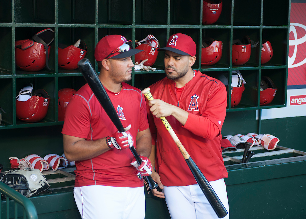 The Angels' Geovany Soto pretends to interview Carlos Perez in the dugout before the Angels' 5-4 loss to the Oakland Athletics at Angel Stadium on Thursday.<br /> <br /> ///ADDITIONAL INFO:   <br /> <br /> angels.0624kjs  ---  Photo by KEVIN SULLIVAN / Orange County Register  --  6/23/16<br /> <br /> The Los Angeles Angels take on the Oakland Athletics Thursday at Angel Stadium.<br /> <br /> <br />  6/23/16