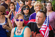 27 AUGUST 2012 - GILBERT, AZ:  People listen to Kirk Adams speak at a campaign event Monday. Adams is running for US Congress. Sarah Palin campaigned for Arizona Republicans aligned with the Tea Party movement at a barbecue in Gilbert, AZ, a suburb of Phoenix. She campaigned for Kirk Adams, who is running for Congress and Jeff Flake, who is running for US Senate. Palin spoke and served barbecued chicken in 108 degree heat.      PHOTO BY JACK KURTZ