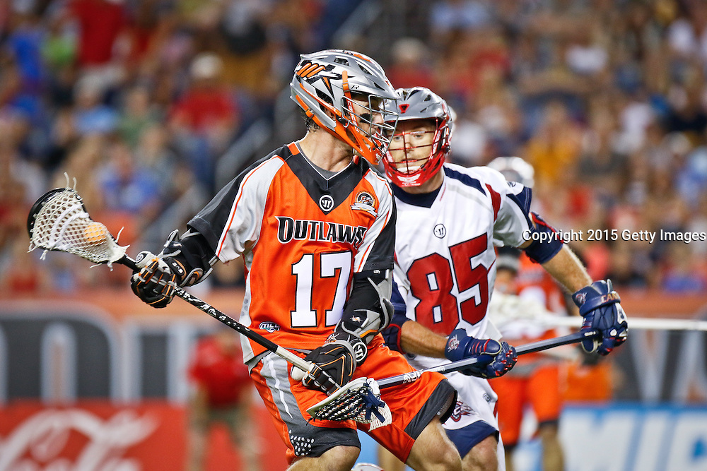 DENVER, CO - JULY 4: Mike Booklet #17 of the Denver Outlaws and Mitch Belisle #85 of the Boston Cannons during their MLL game at Sports Authority Field at Mile High on July 4, 2015 in Denver, Colorado. (Photo by Marc Piscotty/Getty Images) *** Local Caption *** Mike Booklet, Mitch Belisle