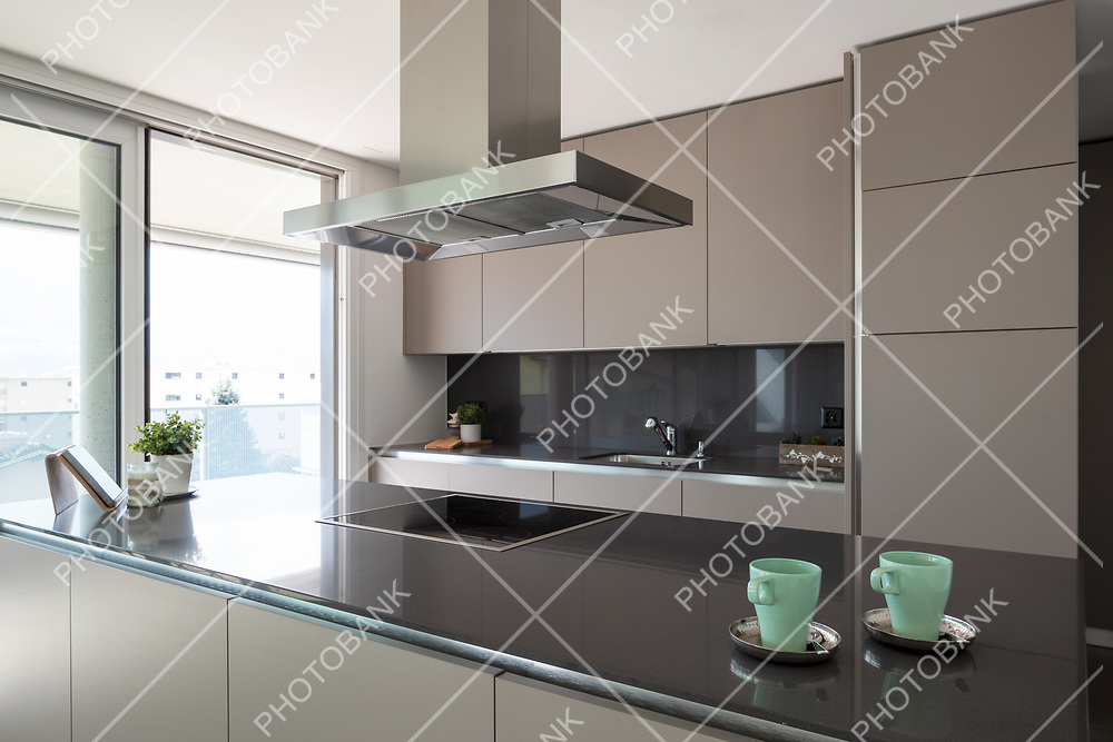 Detail of two breakfast cups in a modern and design kitchen. Nobody inside.