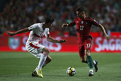 October 10, 2017 - Lisbon, Portugal - Switzerland's defender Fabian Schar  (L) vies for the ball with Portugal's forward Andre Silva (R)  during the FIFA World Cup WC 2018 football qualifier match between Portugal and Switzerland, in Lisbon, on October 10, 2017. (Credit Image: © Carlos Palma/NurPhoto via ZUMA Press)