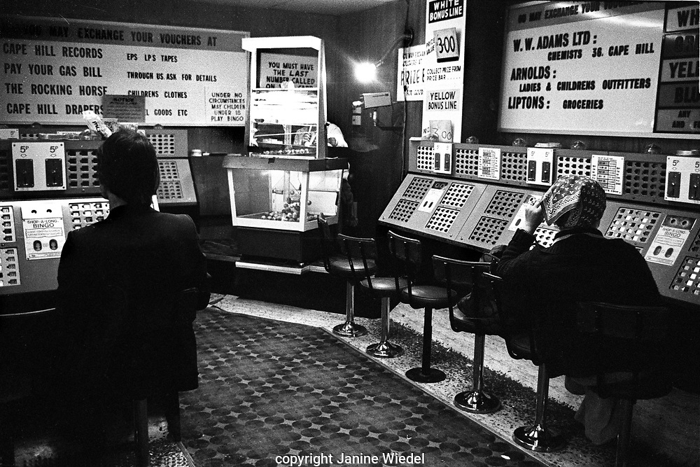 """People playing Bingo in """"shop-along Bingo"""" in the West Midlands in the 1970s"""