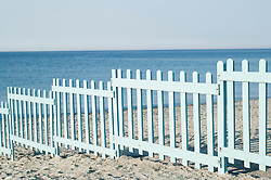 Blue wooden fence barrier beach Italy ocean