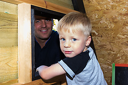 Dad of two Tom Prior has created a beautiful shingle clad, two floor play house in the garden of his Shoreham, West Sussex home for his children. Tom and his son Jackson, 4, at the window. Shoreham, West Sussex, July 15 2019.