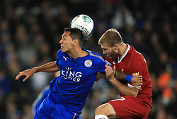 Leicester City's Leonardo Ulloa (left) and Liverpool's Ragnar Klavan battle for the ball during the Carabao Cup, third round match at the King Power Stadium, Leicester.