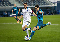 SAINT-PETERSBURG, RUSSIA - OCTOBER 20: Brandon Mechele of Club Brugge KV and Sardar Azmoun of Club Brugge KV in action during the UEFA Champions League Group F match between Zenit St Petersburg and Club Brugge KV at Gazprom Arena on October 20, 2020 in Saint-Petersburg, Russia [Photo by MB Media]