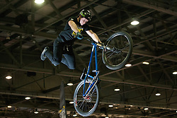 © licensed to London News Pictures. London, UK 12/01/12. Dirt jump star Blake Samson performing for Animal Bike Tour at the London Bike Show at the ExCel, London. Photo credit: Tolga Akmen/LNP