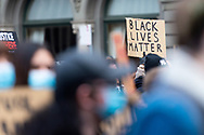 A protestor holds up a sign to show support on 06 June, 2020 in Melbourne, Australia. This event was organised to rally against aboriginal deaths in custody in Australia as well as in unity with protests across the United States following the killing of an unarmed black man George Floyd at the hands of a police officer in Minneapolis, Minnesota. (Photo by Mikko Robles/ Speed Media)
