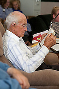 "Aug 10, 2008 -- COLORADO CITY: JOSEPH JESSOP, 86 years old and the patriarch of the Jessop family, reads from the Book of Mormon during a prayer service in the living room of his home in Colorado City, AZ. The Jessops are polygamists and members of the FLDS. Colorado City and neighboring town of Hildale, UT, are home to the Fundamentalist Church of Jesus Christ of Latter Day Saints (FLDS) which split from the mainstream Church of Jesus Christ of Latter Day Saints (Mormons) after the Mormons banned plural marriage (polygamy) in 1890 so that Utah could gain statehood into the United States. The FLDS Prophet (leader), Warren Jeffs, has been convicted in Utah of ""rape as an accomplice"" for arranging the marriage of teenage girl to her cousin and is currently on trial for similar, those less serious, charges in Arizona. After Texas child protection authorities raided the Yearning for Zion Ranch, (the FLDS compound in Eldorado, TX) many members of the FLDS community in Colorado City/Hildale fear either Arizona or Utah authorities could raid their homes in the same way. Older members of the community still remember the Short Creek Raid of 1953 when Arizona authorities using National Guard troops, raided the community, arresting the men and placing women and children in ""protective"" custody. After two years in foster care, the women and children returned to their homes. After the raid, the FLDS Church eliminated any connection to the ""Short Creek raid"" by renaming their town Colorado City in Arizona and Hildale in Utah.     Photo by Jack Kurtz / ZUMA Press"
