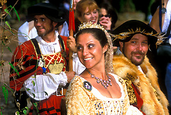 Stock photo of a man and woman in costume smiling at the Texas Renaissance Festival in Plantersville Texas