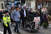 Supporters of Wikileaks founder Julian Assange take part in the March for Assange from BBC Broadcasting House to the Royal Courts of Justice organised by the Dont Extradite Assange campaign on 23rd October 2021 in London, United Kingdom. The US government will begin a High Court appeal on 27th October against a decision earlier this year not to extradite Assange to face espionage charges in the United States. Assange has been held in Belmarsh Prison since 2019.