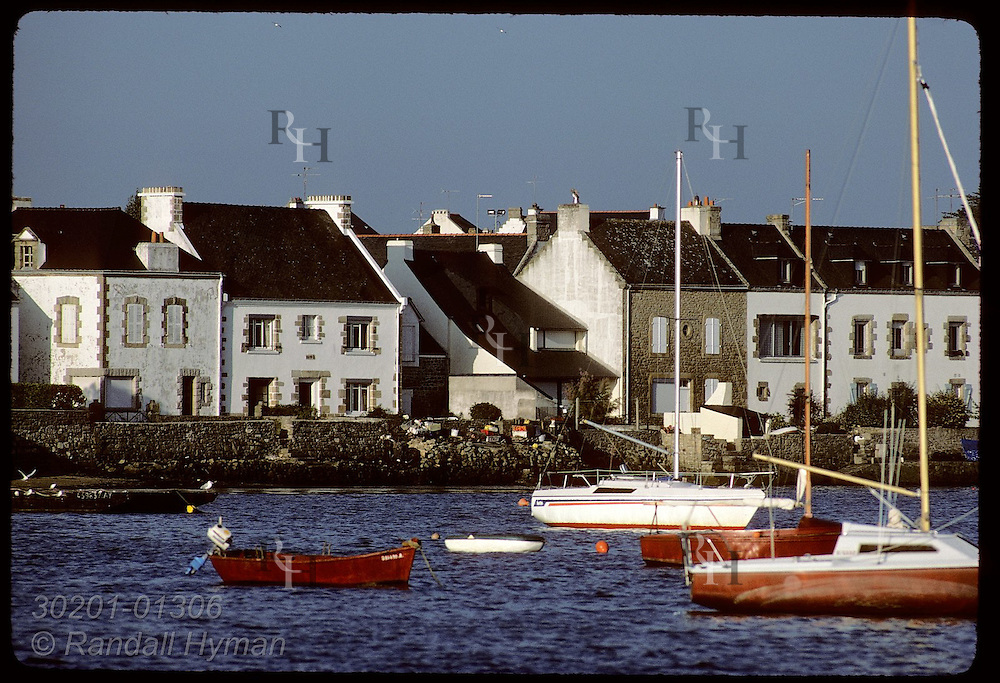 Boats moored at town of Locqmariaquer in the Gulf of Morbihan, Brittany. France