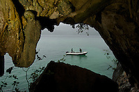 Skull cave with a skull in the wall with the bay and diving tender visible in background.