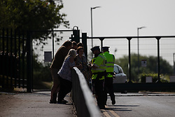 "© Licensed to London News Pictures. 19/07/2018. Salford, UK. Police at the gates to the school . Harrop Fold School in Little Hulton is closed for a protest by parents , objecting to the outcome of a months-long investigation in to record keeping which, it is alleged, revealed that data relating to pupils' performance was embellished and which has seen the school's popular headmaster suspended from duty. Parents planned a protest following the suspension of head master Drew Povey alongside three other members of staff . The school , which has been featured in the documentary "" Educating Greater Manchester "" will remain closed throughout the day . Photo credit: Joel Goodman/LNP"