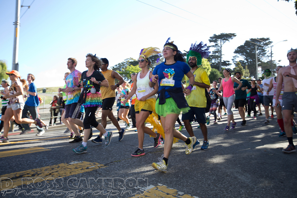 Runners descend the back side of the Hayes Street hill during the 105th running of the Bay to Breakers 12k, Sunday, May 15, 2016 in San Francisco. The 7.42-mile race from San Francisco Bay to the Pacific Ocean, which attracts a field of tens of thousands of runners, from elite runners to weekend warriors, some clad in costume and some in nothing at all.  (Photo by D. Ross Cameron)