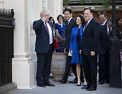 © Licensed to London News Pictures. 14/05/2018. London, UK.  British Foreign Secretary Boris Johnson salutes President Juan Carlos Varela of Panama (R) as Vice President Isabel Saint Malo looks on, during their visit to London. Photo credit: Peter Macdiarmid/LNP