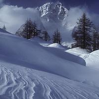 Courmayeur Ski Area, Italian Alps. Wind-sculpted snow. Mont Blanc, Aiguille Blanche.