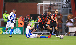 Bournemouth's Jordon Ibe (centre) is tackled by Brighton & Hove Albion's Dale Stephens (left) during the Emirates FA Cup, third round match at the Vitality Stadium, Bournemouth.