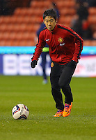 Manchester United's Shinji Kagawa during the warm up before the Capital One Cup match at The Britannia Stadium, Stoke-on-Trent. PRESS ASSOCIATION Photo. Picture date: Wednesday December 18, 2013. See PA story SOCCER Stoke. Photo credit should read: Dave Thompson/PA Wire. RESTRICTIONS: Editorial use only. Maximum 45 images during a match. No video emulation or promotion as 'live'. No use in games, competitions, merchandise, betting or single club/player services. No use with unofficial audio, video, data, fixtures or club/league logos.