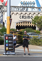 Oct 3, 2017 - Las Vegas, Nevada, U.S. - People come to the perimeter of a police barricade on the Las Vegas Strip. A mass shooting occurred late Sunday evening at the nearby Route 91 Harvest country music festival. (Credit Image: © Ronda Churchill via ZUMA Wire)