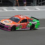 NASCAR Sprint Cup driver Danica Patrick (10) races down the front stretch during the 56th Annual NASCAR Coke Zero 400 race at Daytona International Speedway on Sunday, July 6, 2014 in Daytona Beach, Florida.  (AP Photo/Alex Menendez)