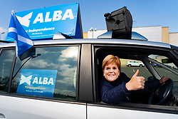Edinburgh, Scotland, UK. 24 April 2021. Campaigner for the Alba party wears mask of Nicola Sturgeon when driving ad van Wester Hailes in Edinburgh today. Iain Masterton/Alamy Live News